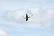 Hispano HA-1112 M1L Buchon G-AWHE vor wolkigen Himmel